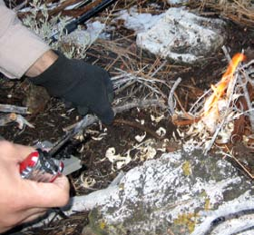 Hiking in Big Bear, California, author had to make a quick fire while taking a break just to keep warm. A small, contained fire is all that is needed for one or two people. Save the big fires for camp.