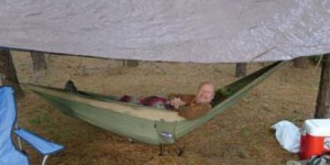 Tim Phillips relaxes in Eagles Nest Outfitters Double Nest Hammock.