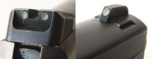 Left: Sights are three-dot night sights. Right: Front sight is installed in dovetail, allowing sights of different heights to be used.
