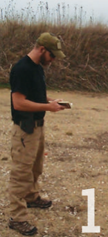 Following instructor's commands, shooter searches for the page and begins to read aloud. Downward position of head and hat brim prevent shooter from peeking at target setup.
