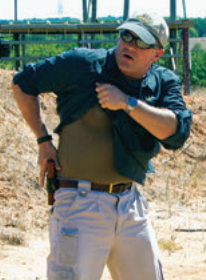 Allan McBee demonstrates ripping up the tail of a buttoned shirt, obtaining a solid grip on the handgun, and following through with a smooth presentation.