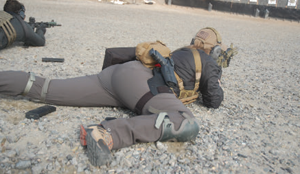 Shooter demonstrates competitive prone position. Cocking the strong leg up puts more mass behind the gun, allowing faster and more accurate rounds downrange.