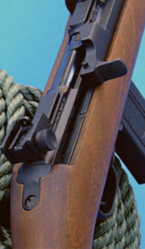 Adjustable rear sight and cocking handle. Like G.I. Carbine, Legacy Carbine incorporates small button on cocking handle. When pushed down, button locks bolt to the rear.