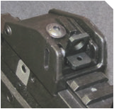 Rear sight is spring loaded, adjustable, sturdy and effective.