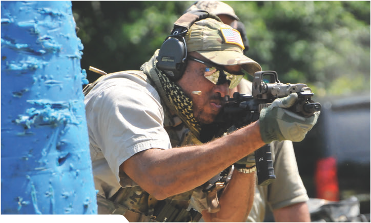 Sean Utley works barriers during full-auto drill on the move.