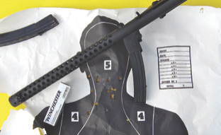 50-yard group fired with Sterling Type II and 124-grain White Box Winchester NATO spec 9x19mm ammo.