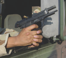 Do not rest your shooting platform on the body of the vehicle.  When shooter rests his wrists on the vehicle, recoil energy dumps straight into his hands, making this 9mm recoil more like a .44 Magnum.