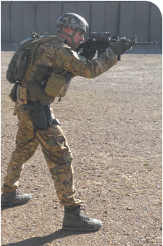 Support hand as far forward as it can go on a carbine rail, with the elbow down in a natural bent position and thumb on top of rail forming a C (being a lefty, a backward C in author's case). Note aggressive stance to drive the gun and minimize recoil. If he wanted to, author could take his firing hand off the grip and the rifle would be fully supported, with little movement to the rifle.