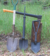 Standard shovel, Glock shovel, USGI E-tool, and axe. Shovel and axe should be in the kit at all times.