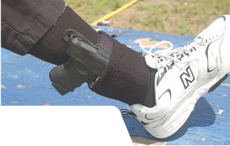 Ankle carry may be an option in an office environment, but inadvertent flashing is also possible. This can be mitigated by donning a second sock to cover the muzzle end of the holster.