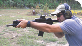 This shooter prefers to run support arm as far out as he can. Same principle of the hand forming a C against the side of the rail applies, but this shooter feels more natural with a straight arm. The straight pull-back of the rifle into the shoulder facilitates driving the rifle onto target.