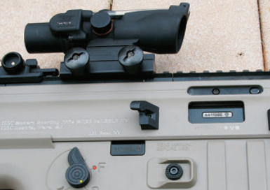 MK22's safety, selector and starboard-side magazine release. Folding stock lock is behind ejection port.