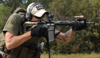 Despite being above average height, this hard shooter's technique has him running his stock all the way in with armor and stretching out on the long handguard. Choice is good.