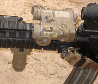Neither foregrip, light, sling swivel nor laser are placed ideally for the shooter, but are each compromises to all fit in the minimal space available with the standard seven-inch rail and carbine gas system.