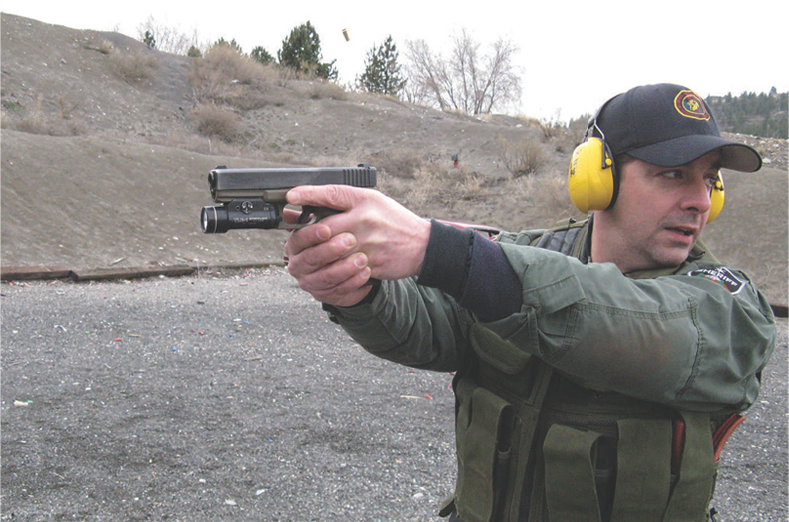 Deputy H.J. Wahples shows how not to do it. He's off the trigger and scanning with a casing still in the air.