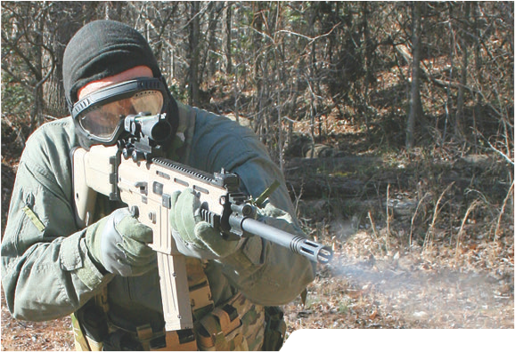 Operator engages threat with MK22. Trijicon 2X20 ACOG was very flexible from close to extended ranges.