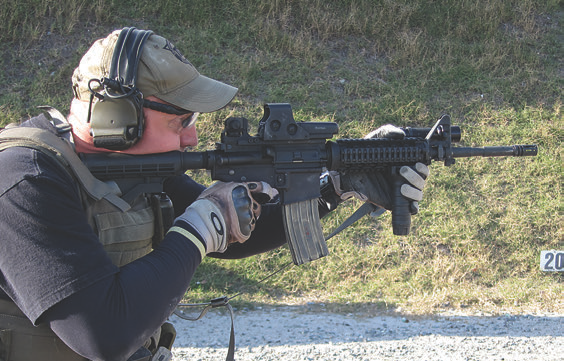 This federal SWAT shooter is running his issue M4 stock partially in, despite the unlimited eye relief of his EOTech holographic sight, allowing an aggressive position. His forward grip is cramped on the standard seven-inch rail, leaving no room to extend in kneeling or prone.