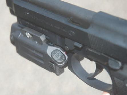 Left-side button operates IR laser and IR illuminator.