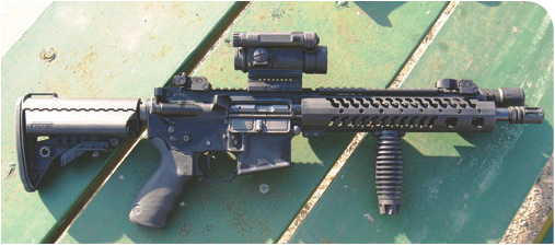 Prototype model 12.5-inch barreled Huldra Tactical Evo model. Author deems it an excellent compromise of ballistics and maneuverability from inside a squad car.