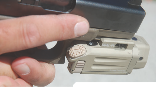 Right-side view mounted on G19. Trigger finger activates VIS switch.