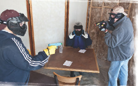 """In the restaurant scenario, author (right) seizes the chance to shoot the robber while the """"Missus"""" looks for a chance to escape."""