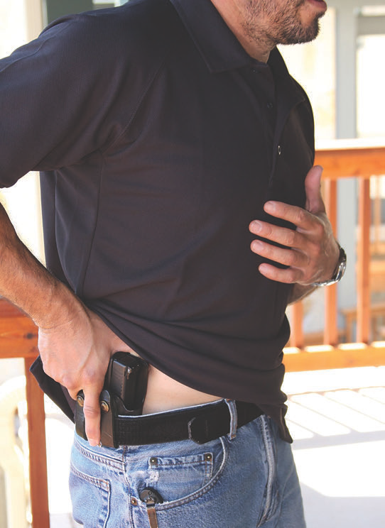 Drawstroke from concealment. Strong-side thumb clears garment and trigger finger is straight.