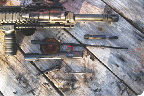 Huldra Arms' bolt carrier group and piston fieldstripped after firing nearly 1,600 rounds. Bolt, firing pin, and cam pin are the same as those used in AR-15/M16/M4 guns, making them easy to replace if wear or breakage occur. It is a simple and reliable system.