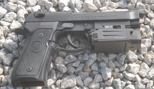 Right-side view mounted on Beretta M9A1 pistol.
