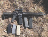 Here with Trijicon TAO1NSN ACOG, Sionics Patrol Rifle III XL carbine ran with an assortment of magazines.
