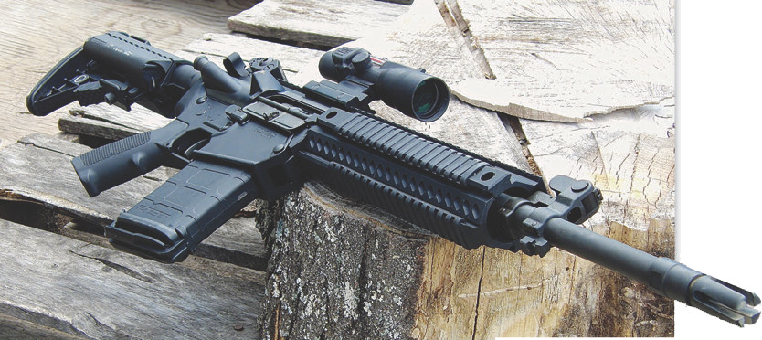 Colt 901 Modular Carbine showing flash hider, rail covers, and Magpul PMAG.