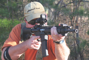 SR-556 Model 5913 carbine shows Ruger versatility in satisfying customer needs by not using a full-length quad rail, but instead a lower profile handguard with adjustable three-inch Picatinny rail sections. The top of the rifle from the back of the receiver to the front of the gas block has a full-length Picatinny rail.