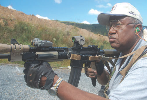 Retired Navy Captain Chuck (Sneakers) Nesby at Basic Carbine Class at Echo Valley Training Center, West Virginia. He is running EAG loaner carbine with IO Cover on Aimpoint T1.