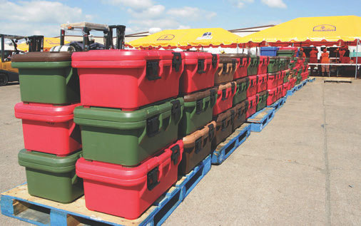 FEMA uses tough insulated containers for storage and shipment of emergency rations, such as these staged in Galveston, Texas in 2008 for distribution by the Red Cross and Salvation Army. Preppers won't be using forklifts to move or access their emergency rations, but the principle is the same: protect your stash from the elements in worthy containers and keep it portable. Photo: FEMA