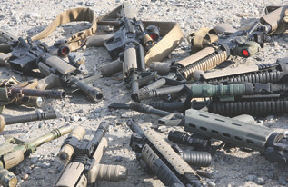 Percentage of BattleComp-equipped rifles has recently been challenging the traditional flash hider, as this group of weapons from an EAG Tactical class shows.