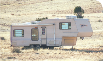 Large trailer is stored in the open for security but can be easily moved to a less conspicuous spot.