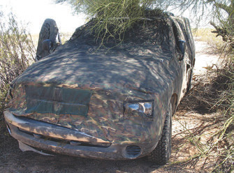 Cartels use stolen vehicles and custom-made camouflage tarps on vehicles to avoid detection when they run them loaded with drugs through the open desert.