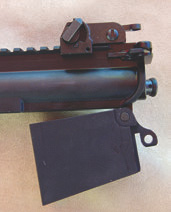 Colt .223/5.56mm upper with conversion unit, which fits into 901 lower's mag well, attached.