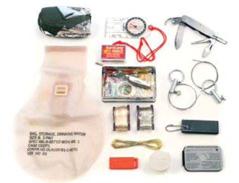 USMC Survival Kit with all its components. Author rates this as one of the best kits that can be bought for the money spent.