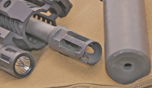 Spot-welding SureFire muzzle device to SOT Hanson 14.5 means weapon no longer needs NFA paperwork to be legally attainable in most states.