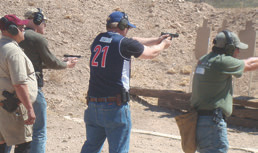 At Tucson shooting, local hero and armed citizen Joe Zamudio (center in blue shirt), who rushed to help stop the shooter, attended training with the Massad Ayoob Group to improve his skills.