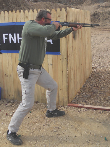 """Mike Duskin uses fighting stance in competition. Even though Mike is 6' 7"""" tall, weighs 270 pounds and has no trouble manhandling the shotgun on target, he still takes the extra fraction of a second to get deep into a fighting stance. This results in an increased ability to settle the gun faster between shots. Less overall time engaging targets means a better score for that stage."""