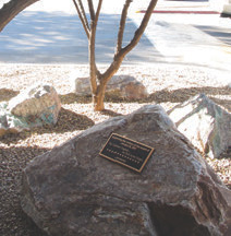 Site of Tucson shooting, a suburban shopping center, bears a discreet memorial. Arizona firearm and armed self-defense rights are stronger today than they were before the tragedy. Inset: Memorial at site of Tucson shooting.