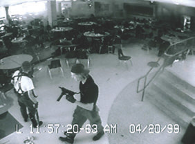 Surveillance video of shooters attacking cafeteria at Columbine High School in Colorado.