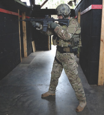 """Author uses classic """"feet shoulder width apart"""" stance. While he can take shots standing like this, he's not set up to run and drive the gun to his maximum ability."""