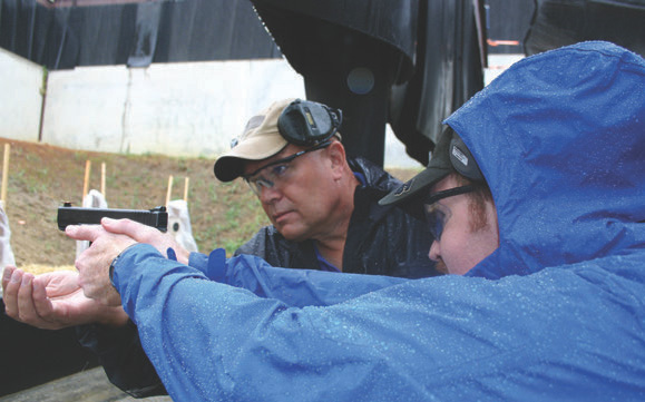 Wayne works with student on dry-fire drill with coin balanced on front sight.Wayne works with student on dry-fire drill with coin balanced on front sight.