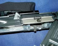 Colt/Umarex with upper rotated open— note dust cover is merely cosmetic. Bolt and chamber are self-contained unit in the upper.