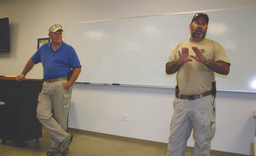 Wayne Dobbs and Darryl Bolke lecture in the classroom.