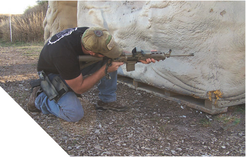Shooter leans out enough to engage target, minimizing his exposure.