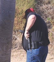 Tactically unsound reload performed at waist level takes more time to get back on target. Plus you lose sight of what is happening downrange.