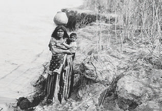 "Got water? The Greeks stated it well: ""The first of things, is water."" Your survival trek ends soon without it. Mojave woman with baby on hip deftly balances water carrier—handmade without tools—on her head circa 1905. Photo: Edward S. Curtis, courtesy Library of Congress"